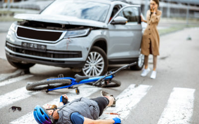Who pays your medical bills and lost wages if you are hit by a car while walking or riding your bike?
